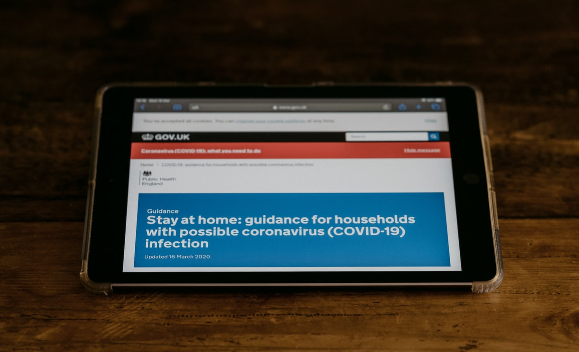 tablet screen showing government advice on coronavirus